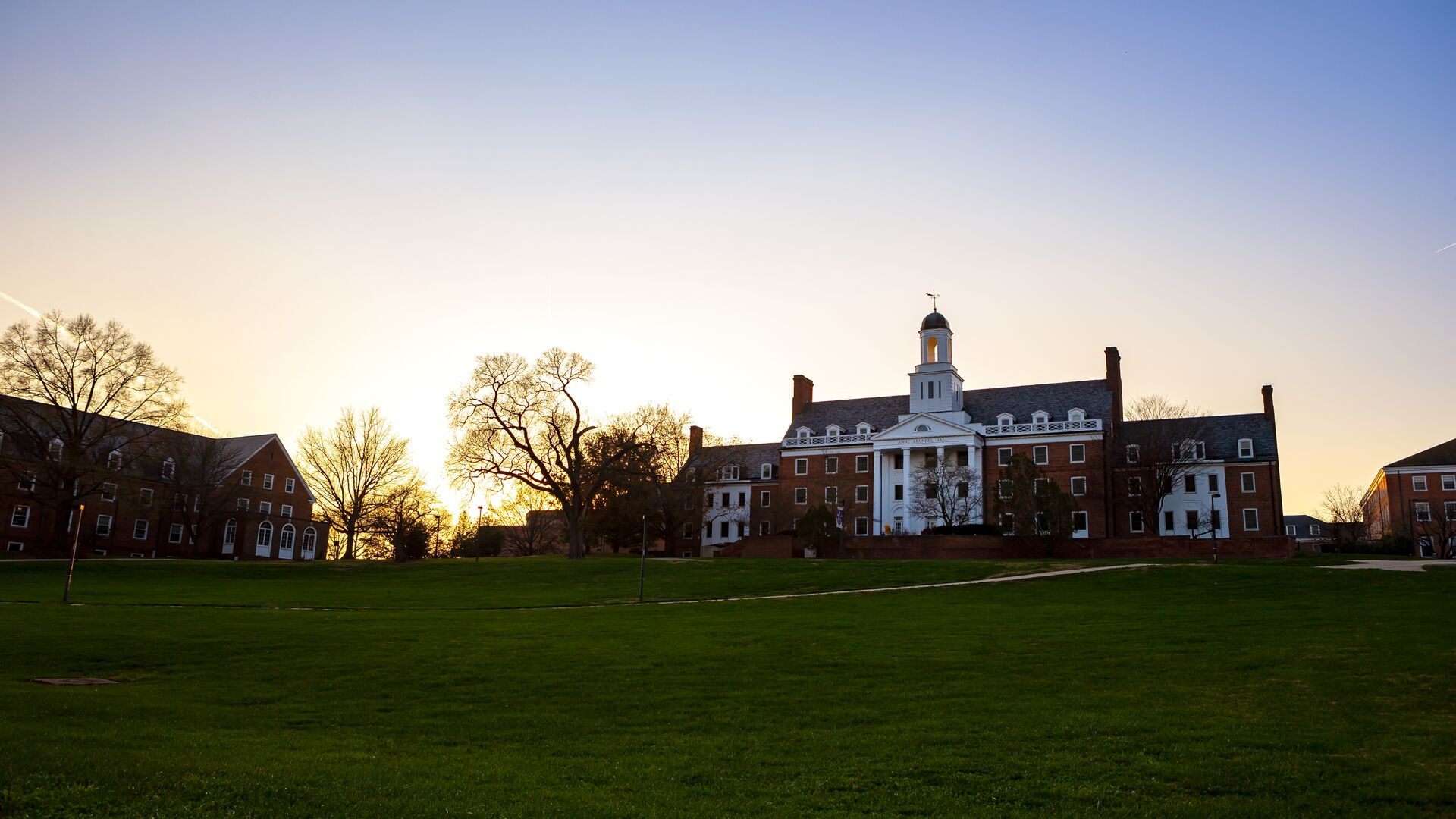 View of Anne Arundel Hall and Queen Anne's Hall at dusk during the winter months.