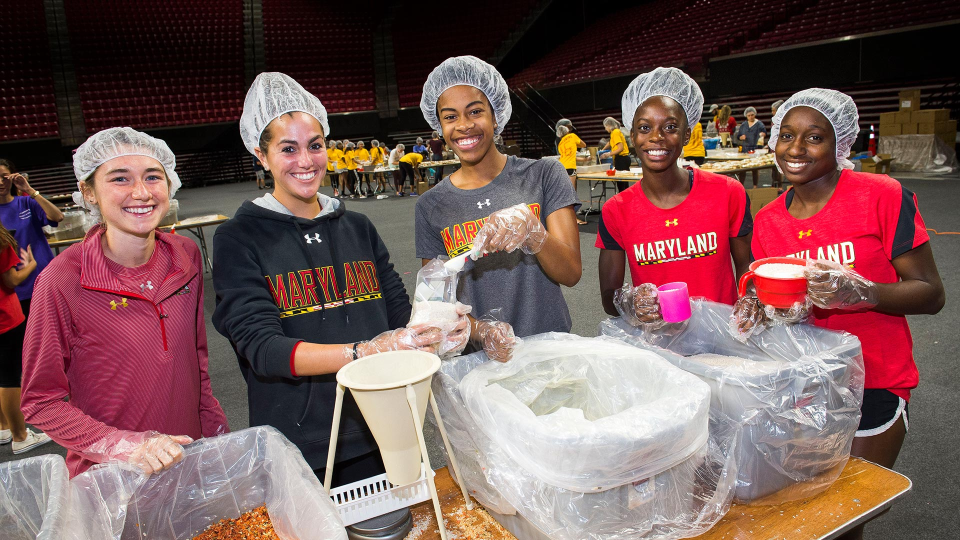Homecoming Service Day on Sunday Packs Meals for Those in Need